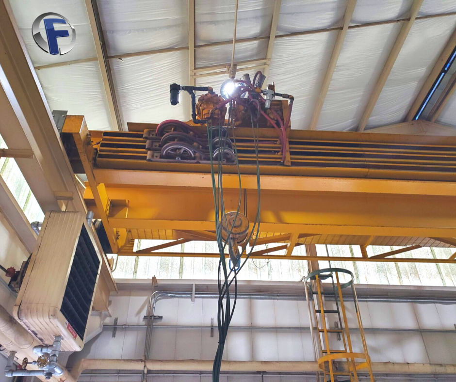 Swapping out the hoist in this overhead crane.